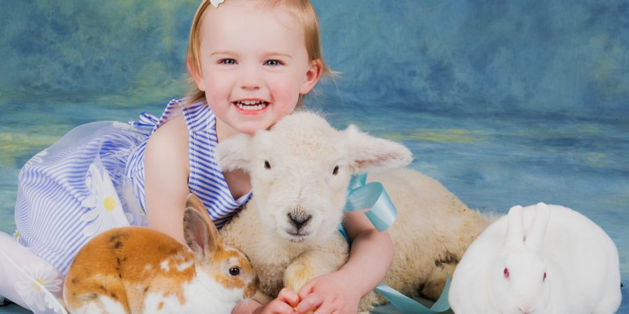 small girl with easter animals